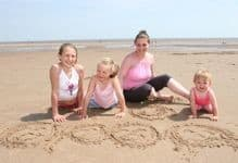 A-family-enjoys-an-FHA-supported-holiday-in-Skegness