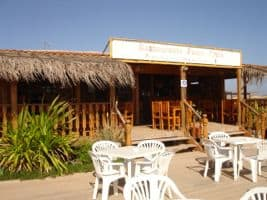 Ponta Preta beach bar - watch the surfers over a chilled beer & grilled fish