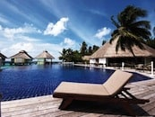 pool-and-loungers-at-chaaya-reef-ellaidhoo