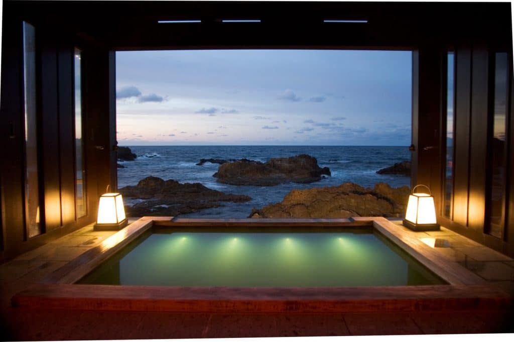 Stunning outdoor hot spring bath at the exclusive Lamp no Yado Ryokan on the Noto Peninsula