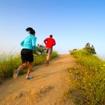 Two people running at Runyon Canyon Park, Hollywood Hills, California USA