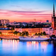 Summer sunset over Riddarholmen, a small islet connected to the old town of Stockholm. In the photo one of the oldest buildings in Stockholm stands out, the Riddarholm Church, the burial church of the Swedish monarchs.