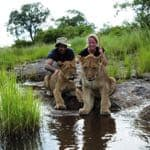 Amar and guide with lions in South Africa