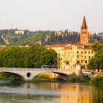 Verona, northern Italy. View of city and river in evening sunlight.